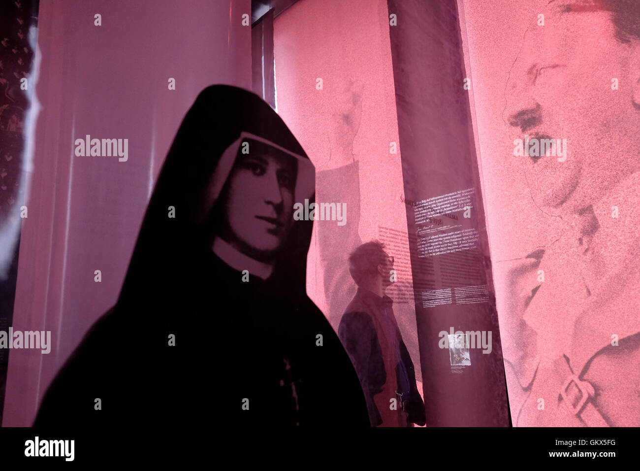 People pass through WW2 retrospective  installation in the Srodmiescie district of Warsaw, Poland - Stock Image