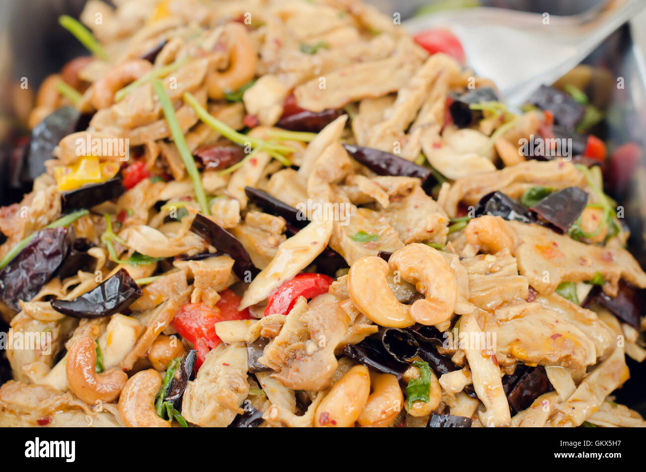 Thai food, stir fired chicken with cashew nuts a famous thai dish - Stock Image