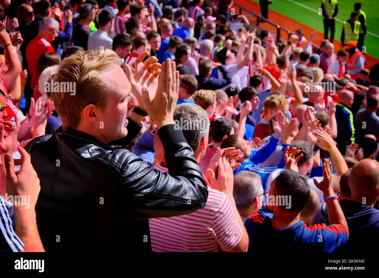 A man applauds his team Sunderland AFC onto the pitch at Aston Villa's Villa Park - Stock Image