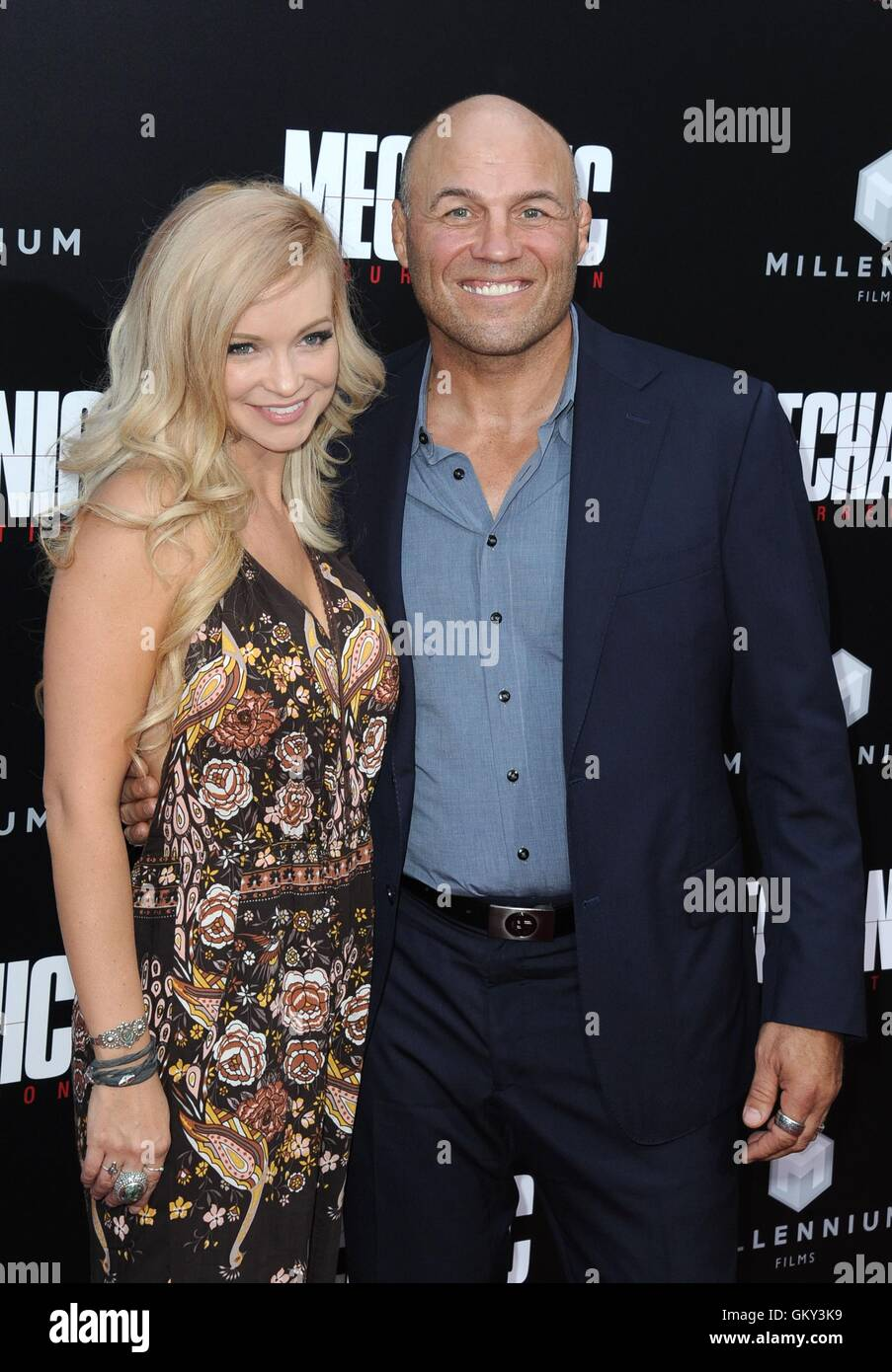 Hollywood, CA. 22nd Aug, 2016. Randy Couture, Mindy Robinson at arrivals for MECHANIC: RESURRECTION Premiere, Arclight Stock Photo