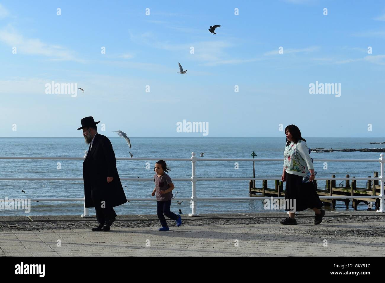 Aberystwyth Wales UK, Tuesday 23 August 2016 UK weather: An orthodox hassidic Jewish family on holiday at the seaside - Stock Image