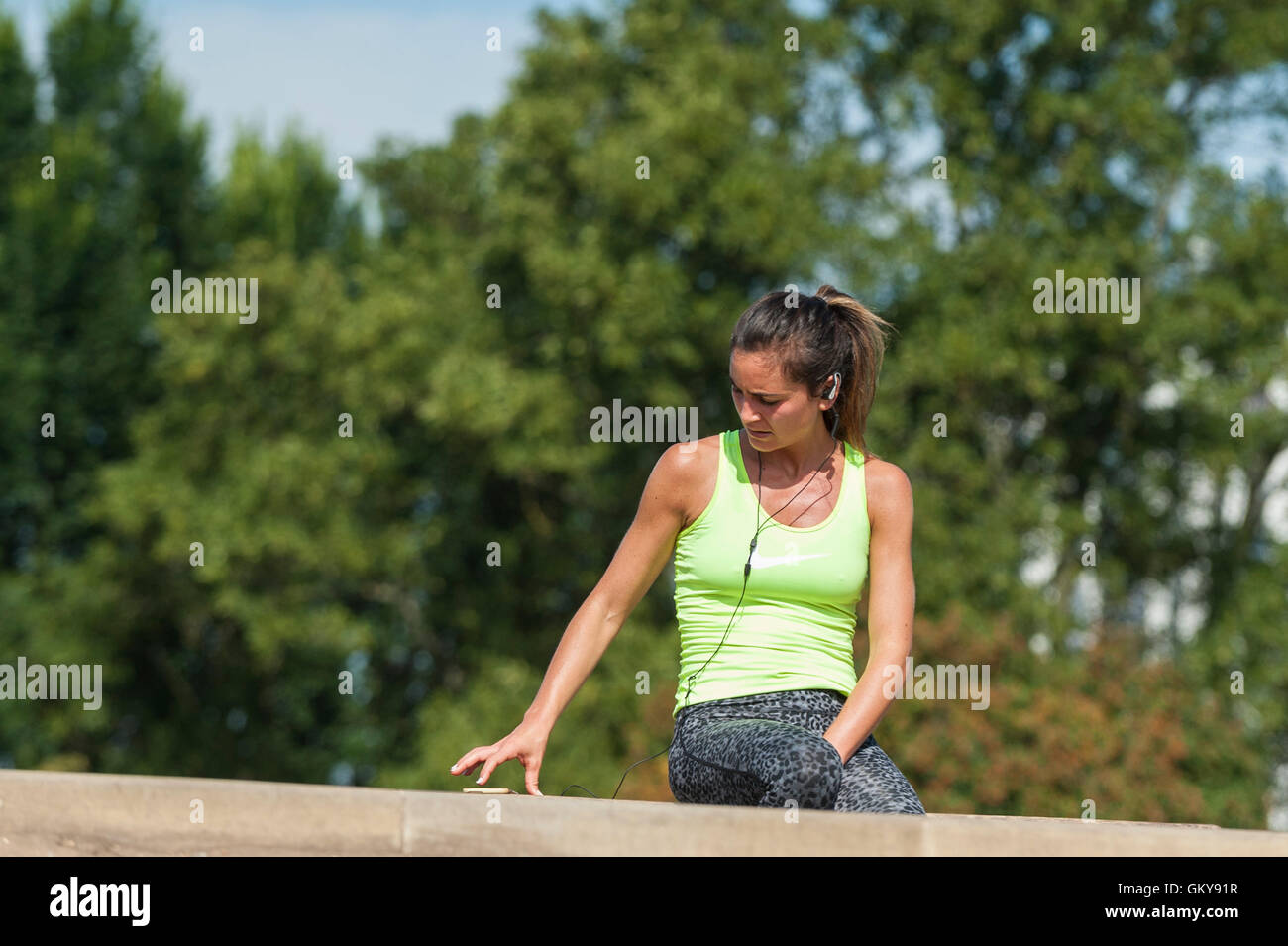 London, UK.  24 August 2016.  A sunbather enjoys the sunshine on Primrose Hill as a mini heatwave brings sunshine - Stock Image