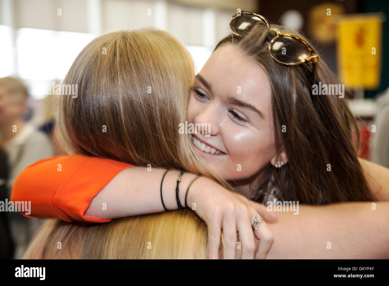 Southport, Merseyside. 25 Aug 2016.  Pupils from 'Christ The King Catholic High School' in Southport, celebrate - Stock Image