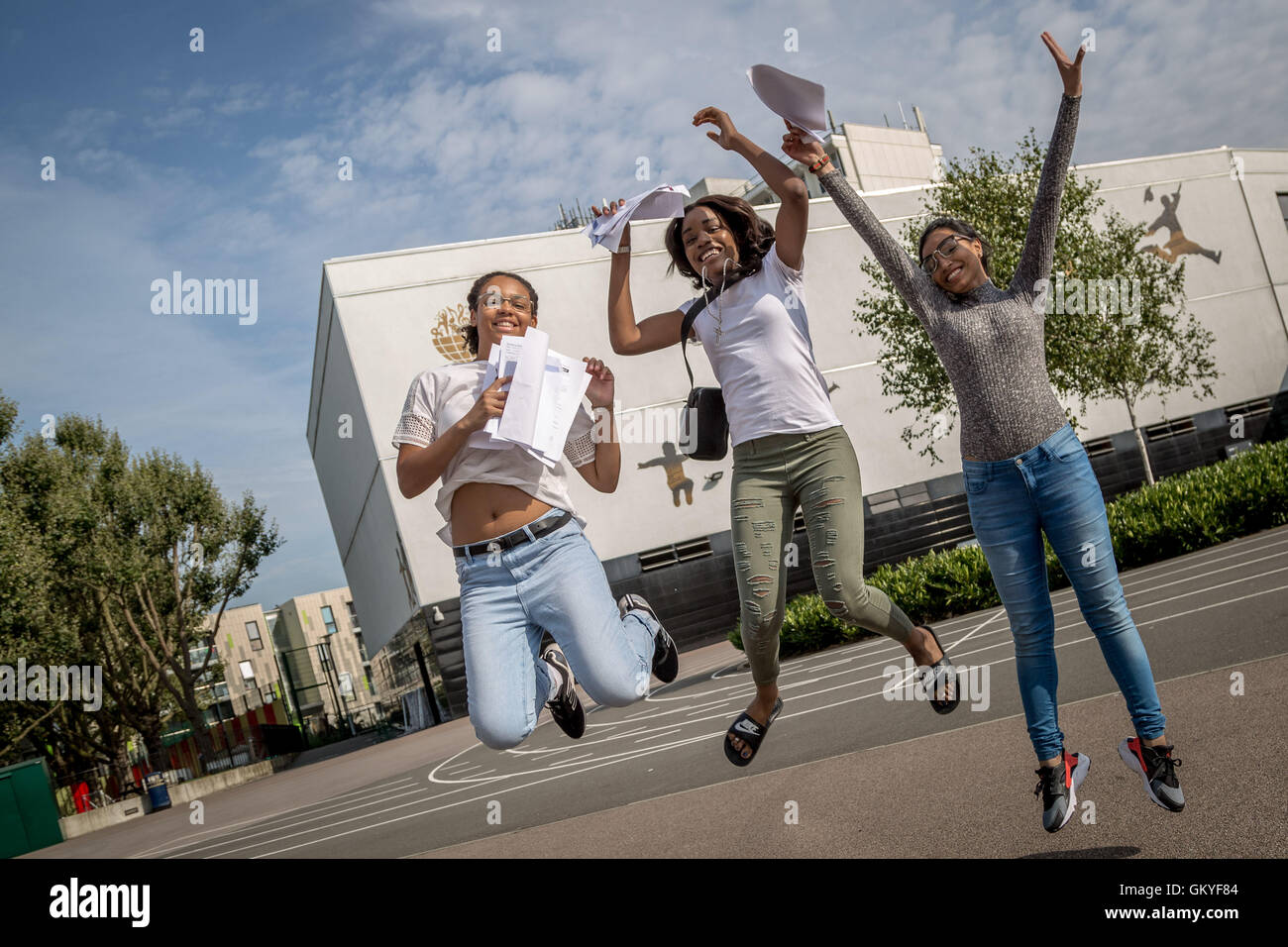London, UK. 25th August, 2016. Pupils jump for joy after collecting their GCSE exam results at Ark Globe Academy - Stock Image