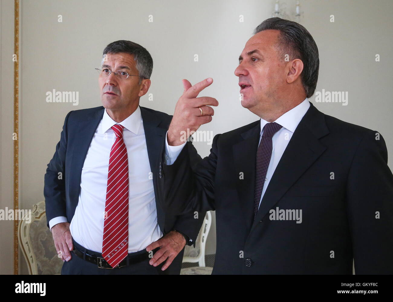 MOSCOW, RUSSIA – AUGUST 25, 2016: Adidas Group CEO Herbert Hainer (L) meets with Russian Sport Minister Vitaly Mutko. - Stock Image