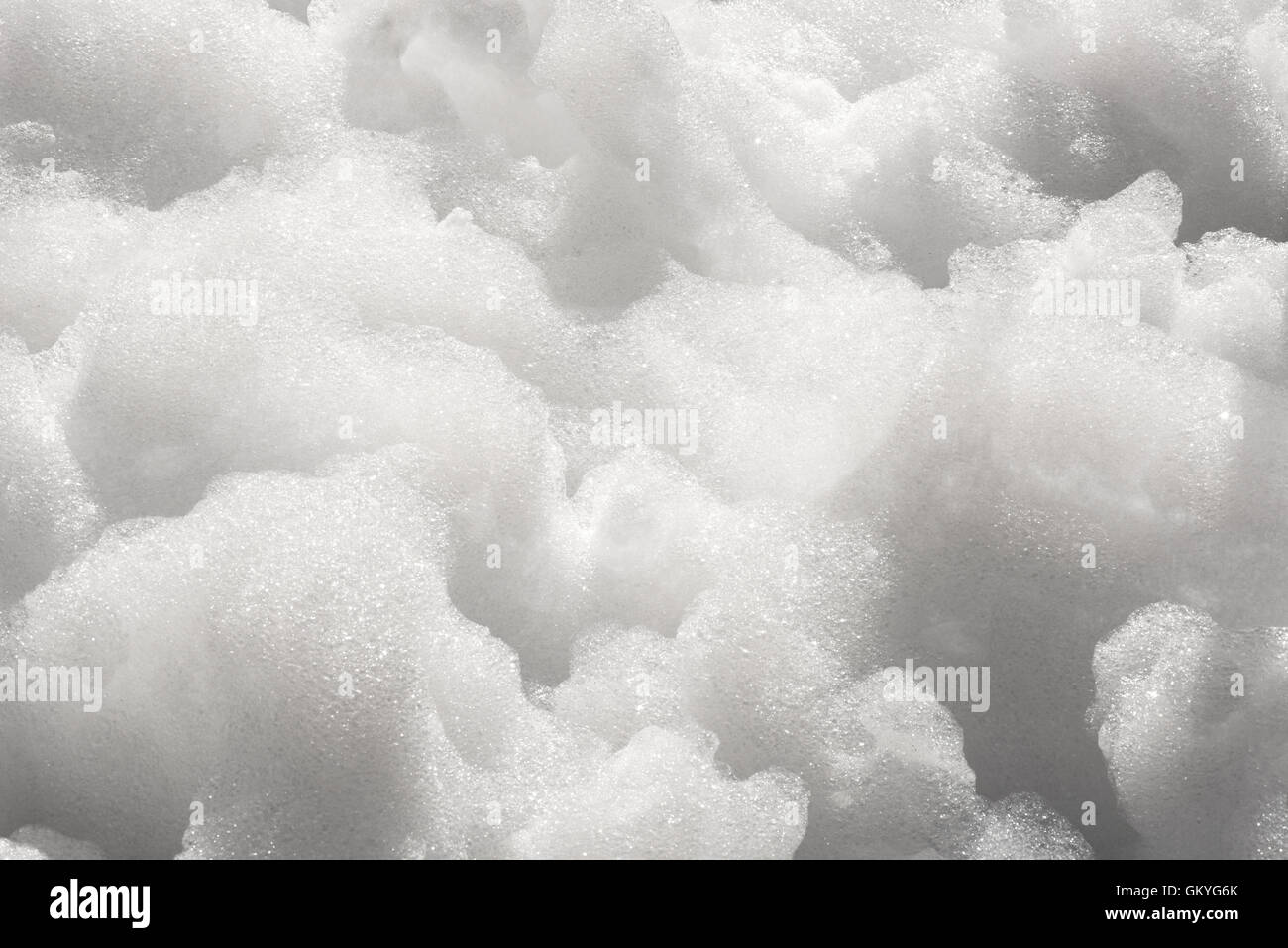 Close up detail of thick white soapy foam bubbles in a full frame background texture - Stock Image