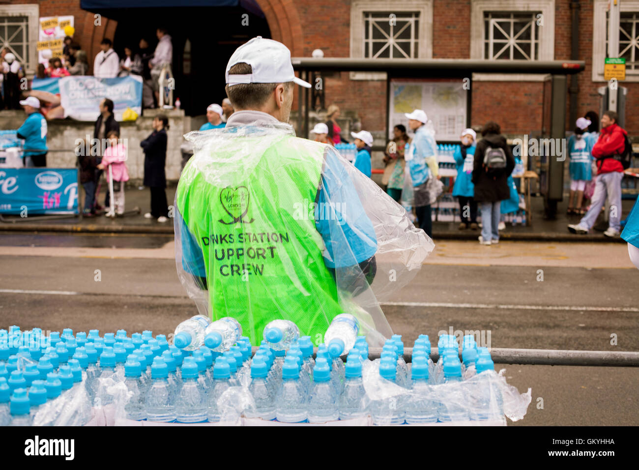 A gentlemen mans the water station at the Virgin London Marathon 25th April 2010 - Stock Image