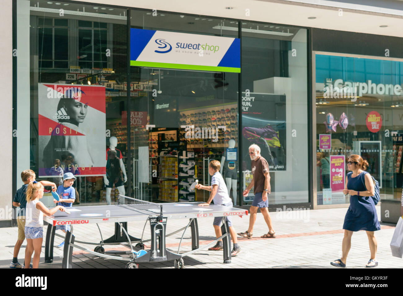 Exeter, Devon, United Kingdom - August 23, 2016: Table tennis players in front of Sweatshop store in Exeter. - Stock Image