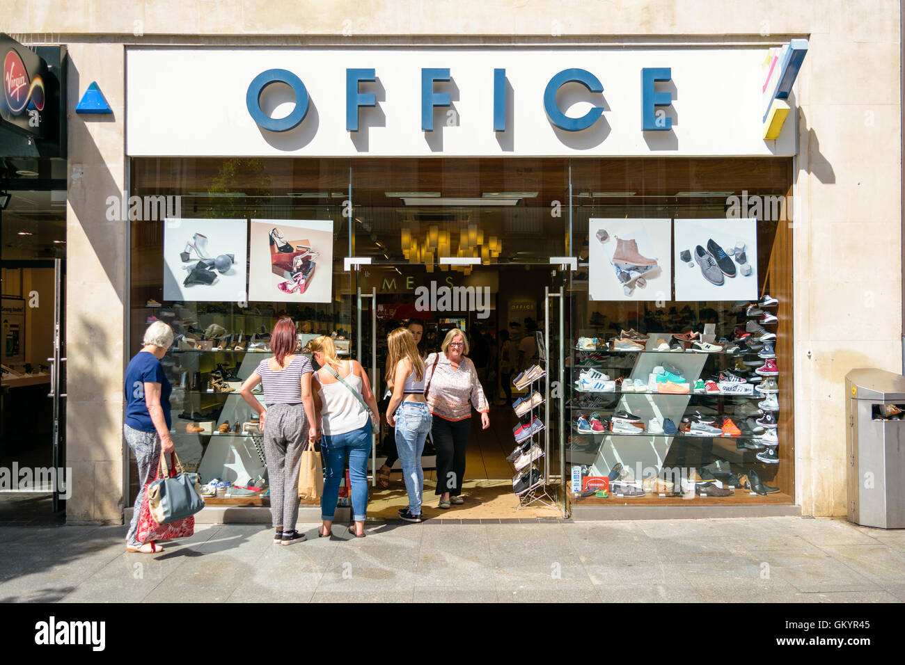 Exeter, Devon, United Kingdom - August 23, 2016: Women look at shoes ...
