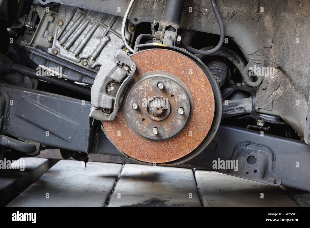 Old and rusty car disc brake and caliper - Stock Image