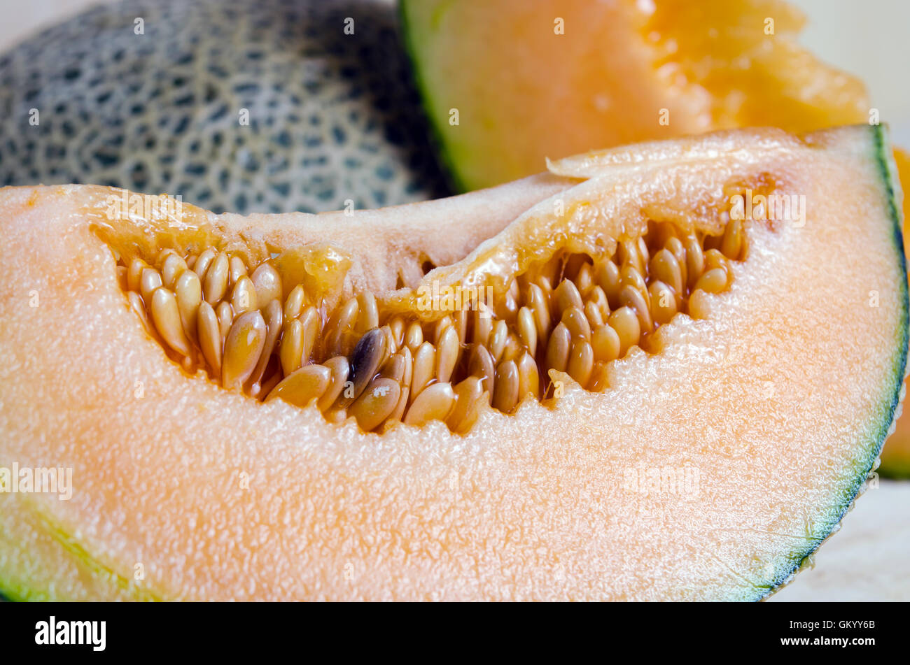 Cucumis melo or melon with half and seeds on wooden plate (Other names are cantelope, cantaloup, honeydew, Crenshaw, - Stock Image