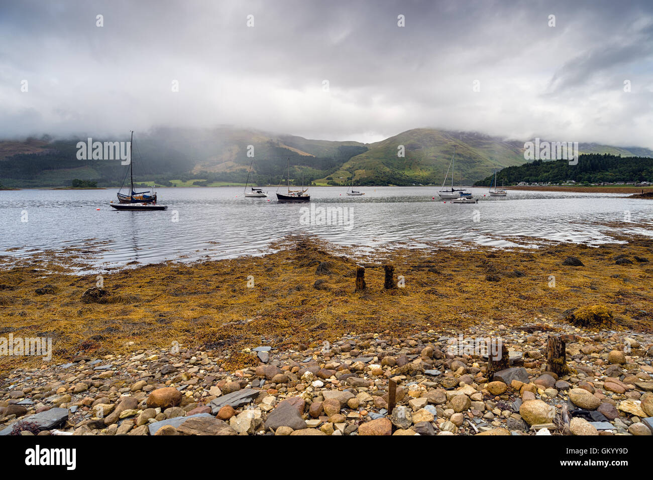 Boats at Loch Leven near Glencoe in the Scottish Highlands - Stock Image