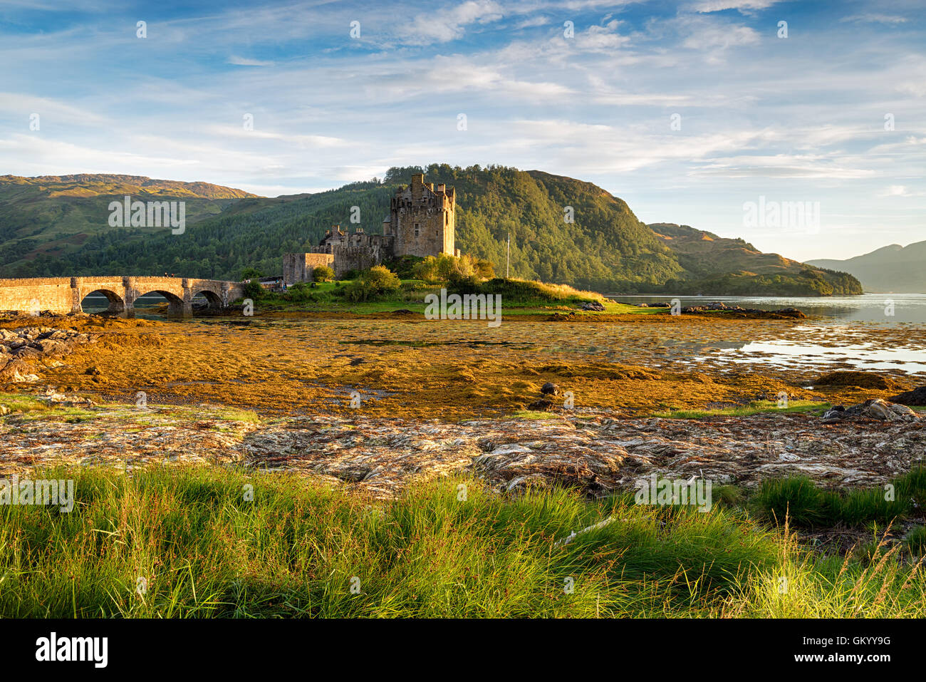 Evening sunlight on the castle at Eilean Donan in the Western Highlands of Scotland - Stock Image