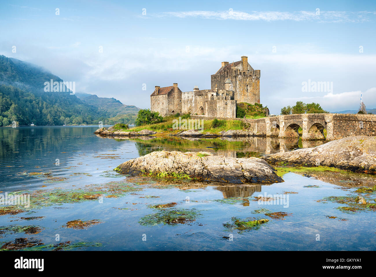 Early morning sunlight over Eilean Donan Castle at Kyle of Lochalsh in the Western Highlands of Scotland Stock Photo