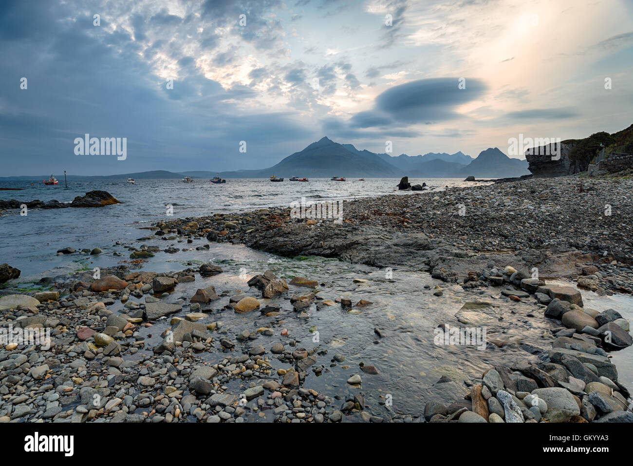 A stormy evening on the beach at Elgol on the Isle of Skye in Scotland, looking across Loch Scavaig to Soay - Stock Image