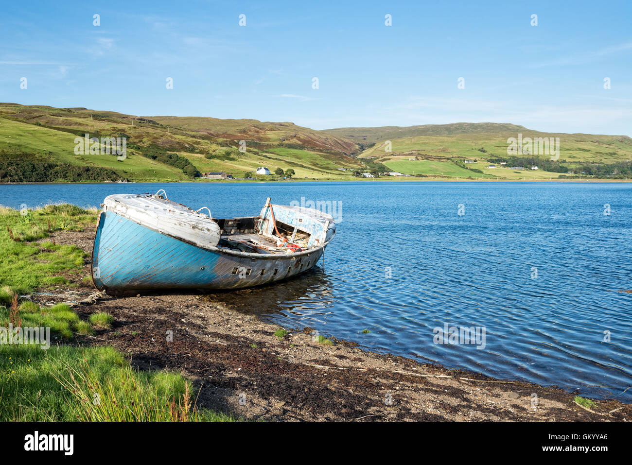 An old fishing boat on the shores of Loch Harport near Drynoch on the Isle of Skye in Scotland Stock Photo
