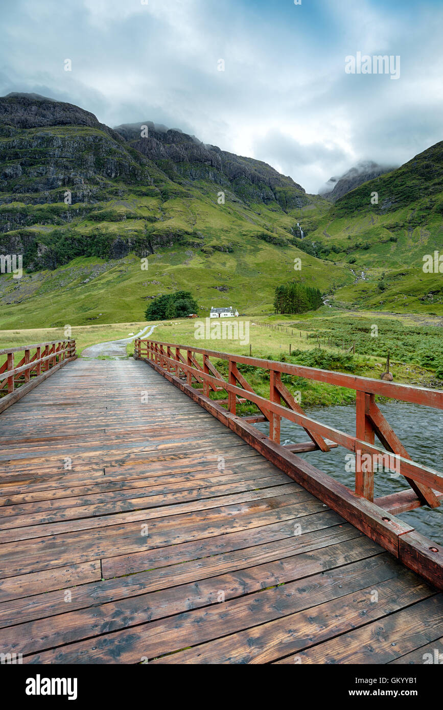 A mountain cottage at Glencoe in the highlands of Scotland - Stock Image