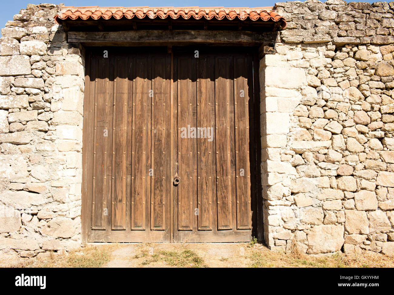 old big wooden doors closed the wall around is built with stones & old big wooden doors closed the wall around is built with stones ...