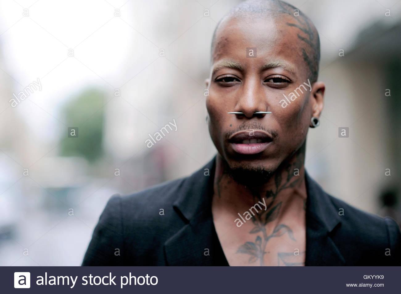 Tattooed man with nose piercing, Le Marais, Paris, France. - Stock Image