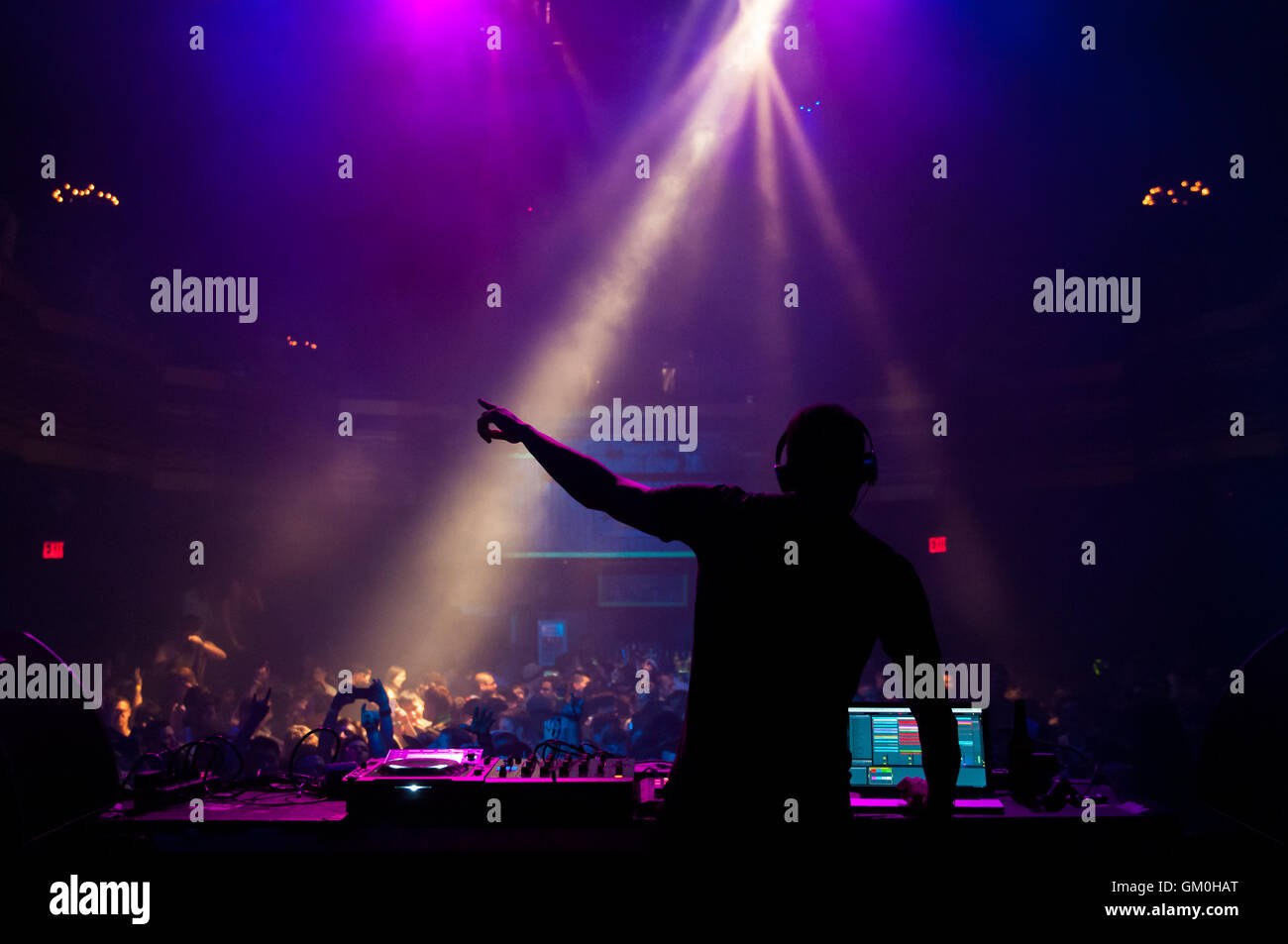 A DJ performing at a concert - Stock Image