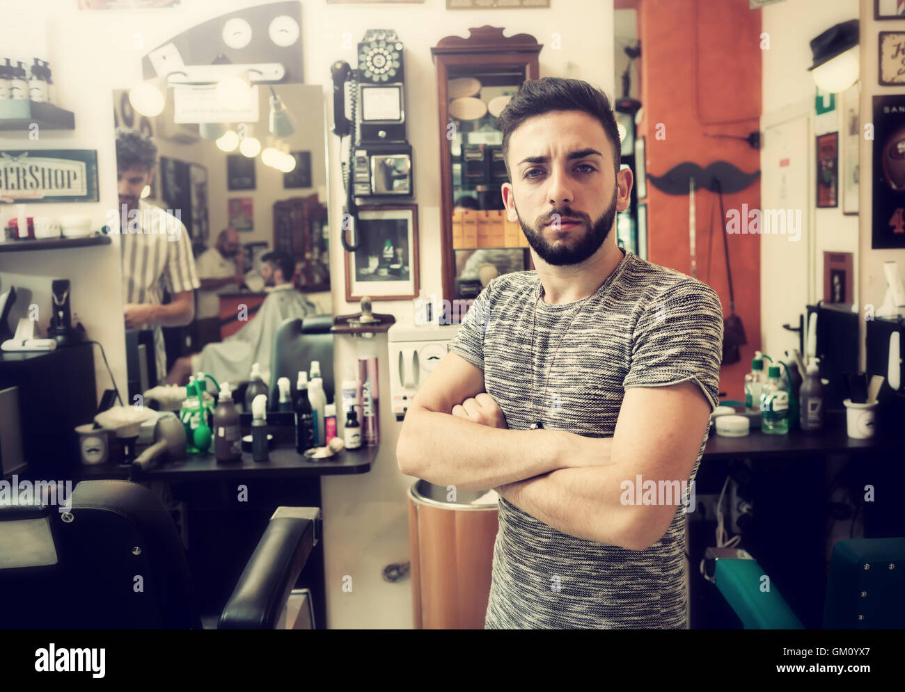 Traditional ritual of shaving the beard in a old style barber shop. - Stock Image