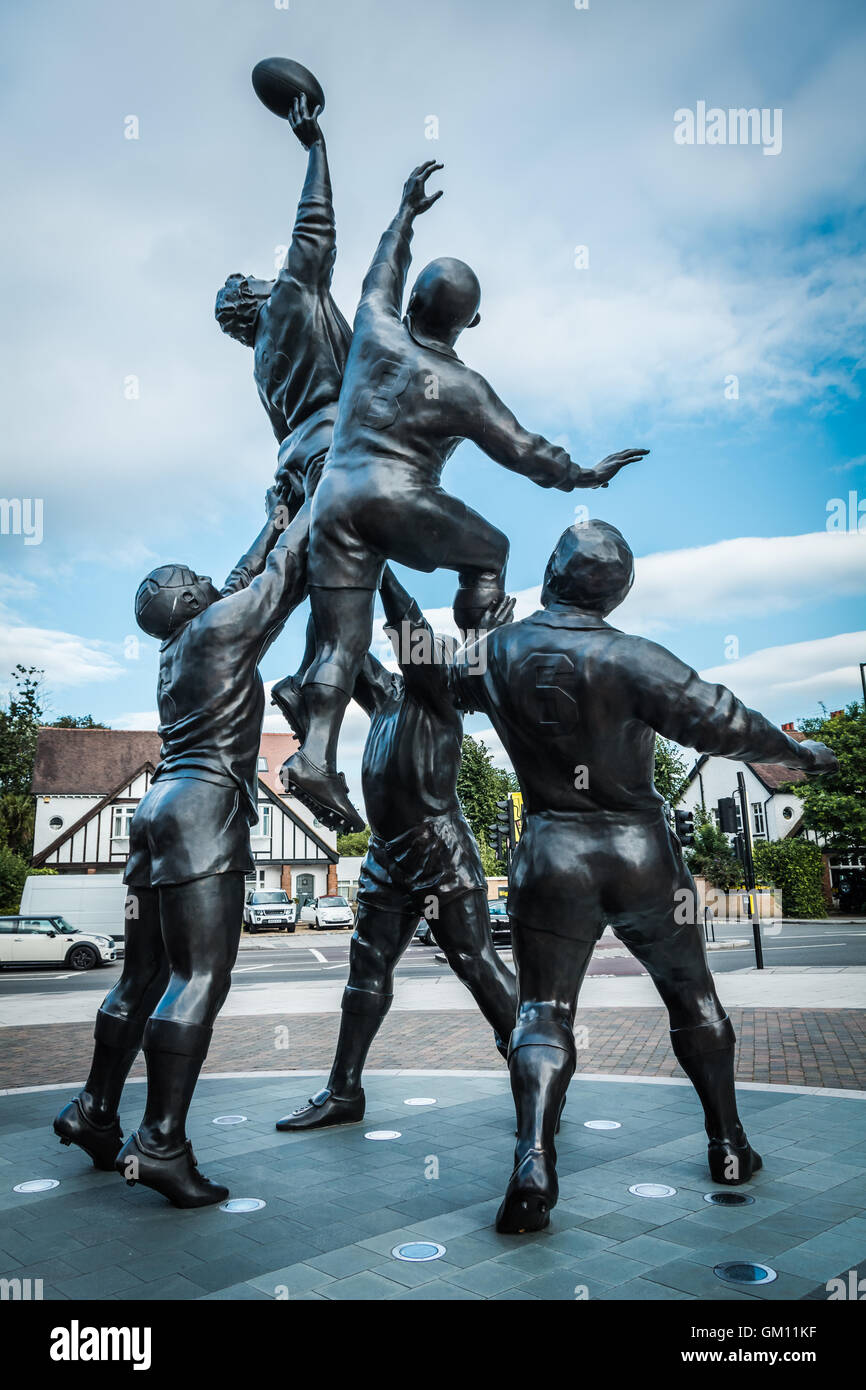 Iconic bronze of rugby line-out by sculptor Gerald Laing outside Twickenham Stadium, London, UK. - Stock Image