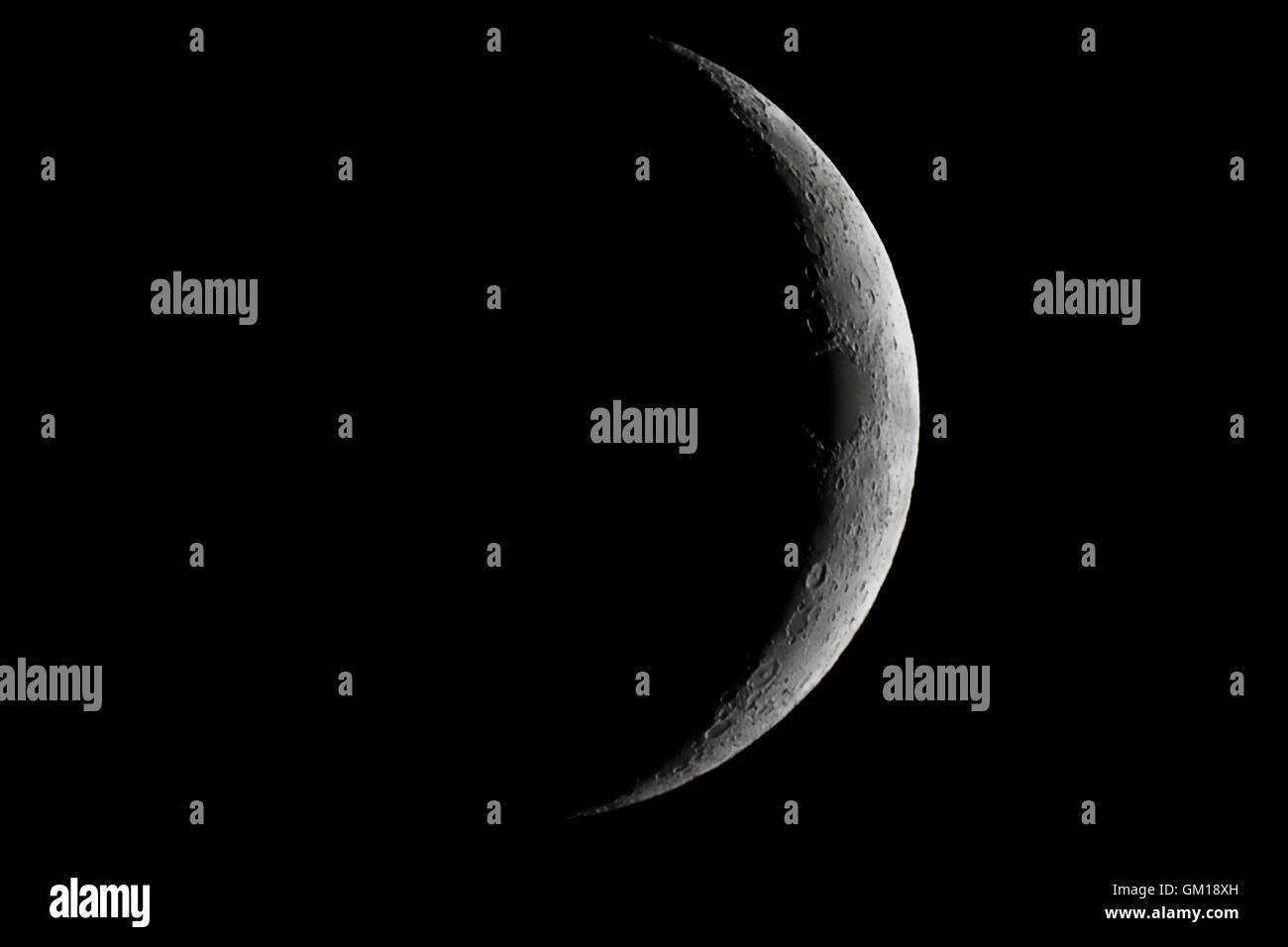 Moon waxing crescent. Young Moon. Crescent moon on black sky. Waxing Crescent. - Stock Image