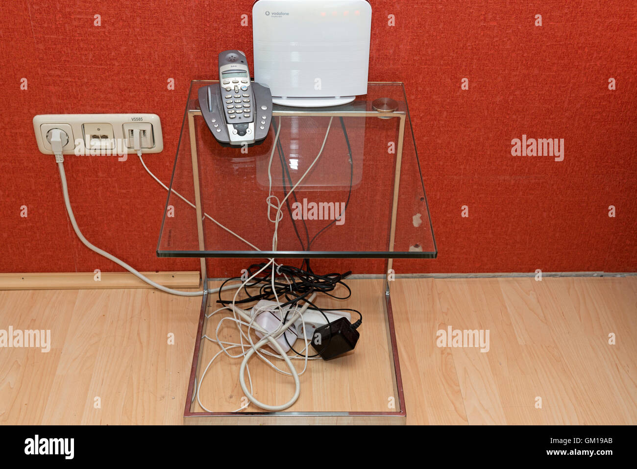 Landline and Wi-Fi box in a German home - Stock Image