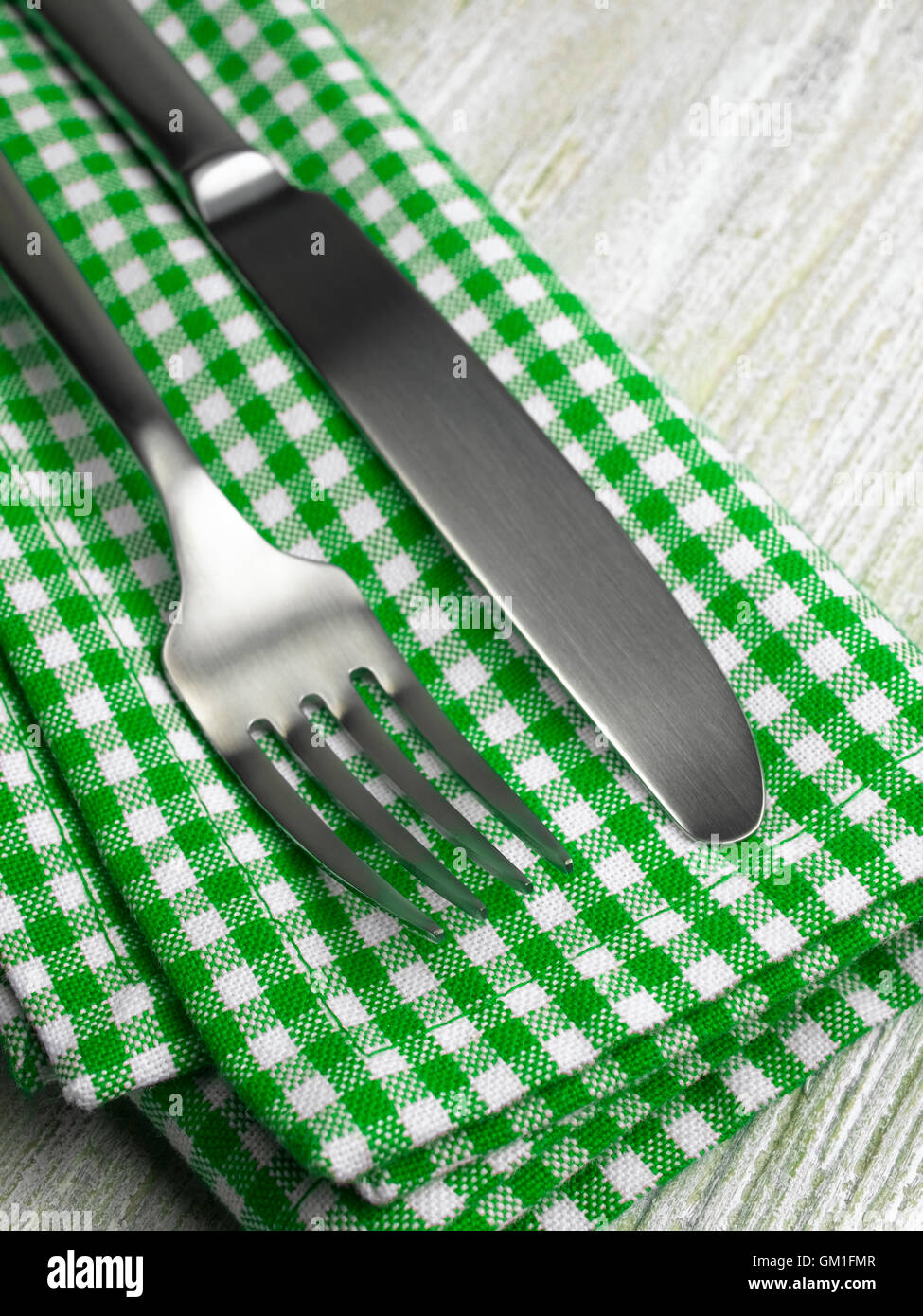Green Napkin and cutlery - Stock Image