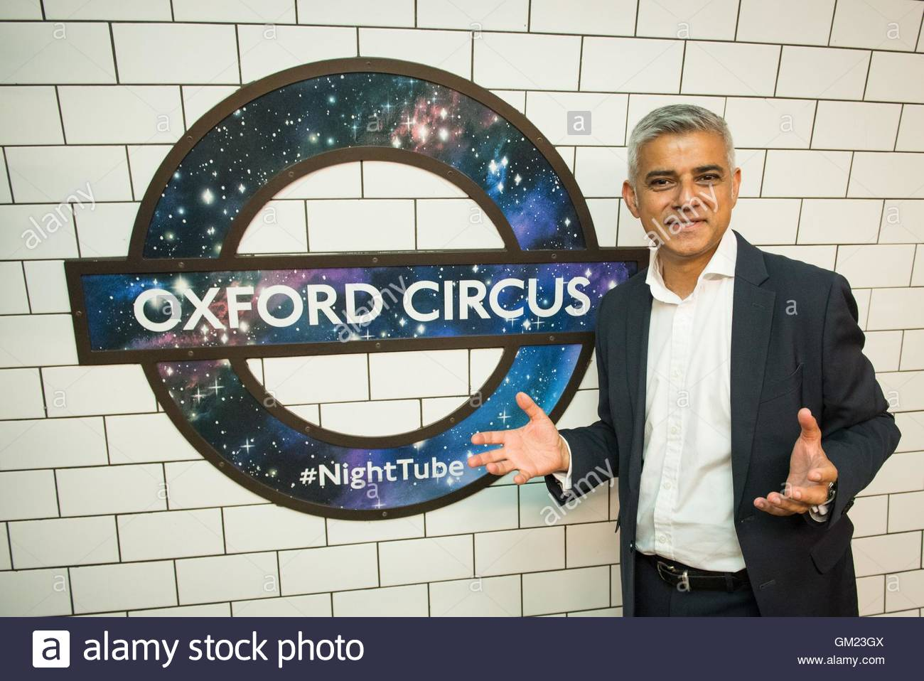 File photo dated 18/08/16 of Mayor of London Sadiq Khan in front of a new Night Tube logo at Oxford Circus underground - Stock Image