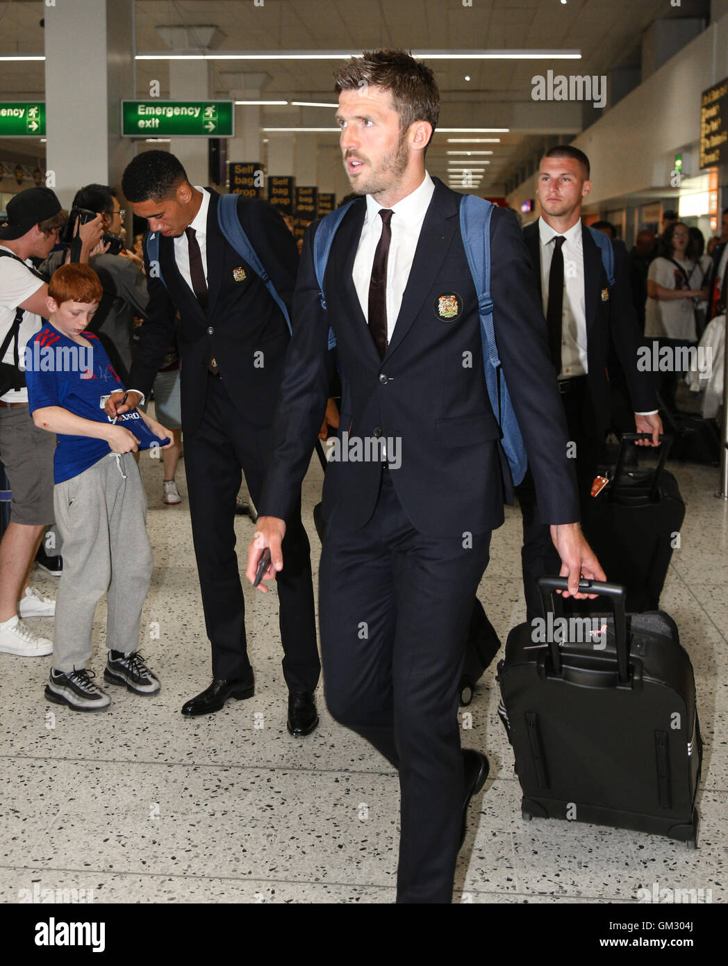 Michael Carrick leaves Manchester airport for Manchester United's pre-season tour of China. - Stock Image