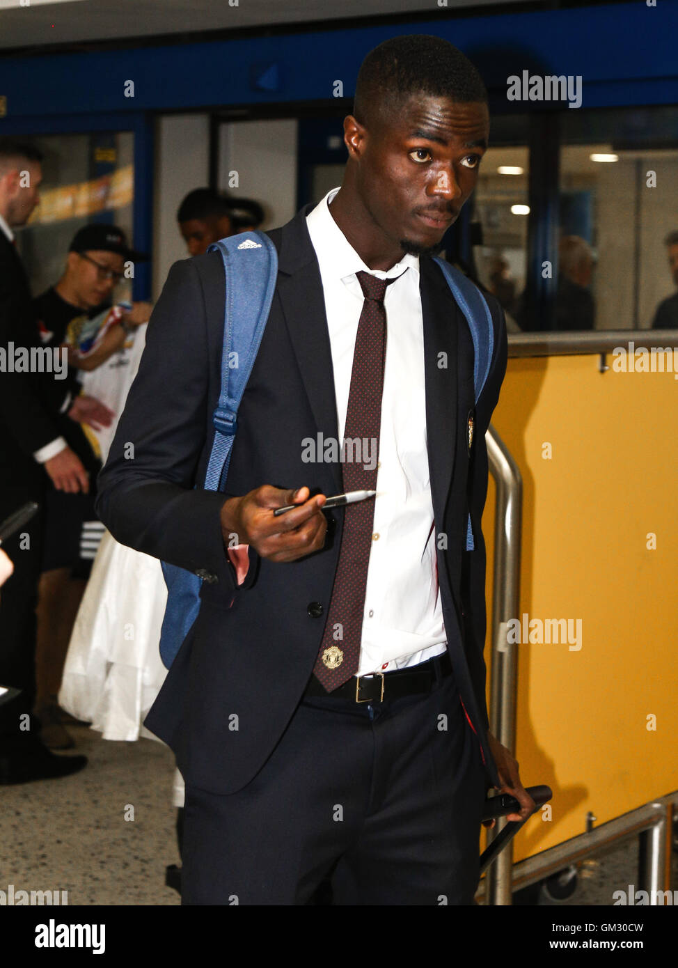 Eric Bailly leaves Manchester airport for Manchester United's pre-season tour of China. - Stock Image