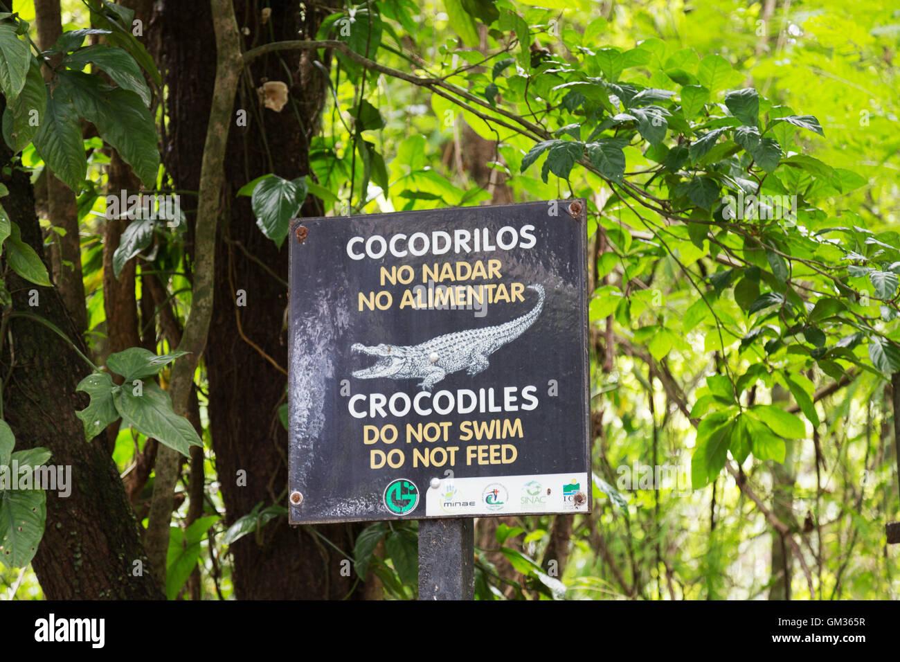 Beware of crocodiles danger sign, Costa Rica, Central America - Stock Image