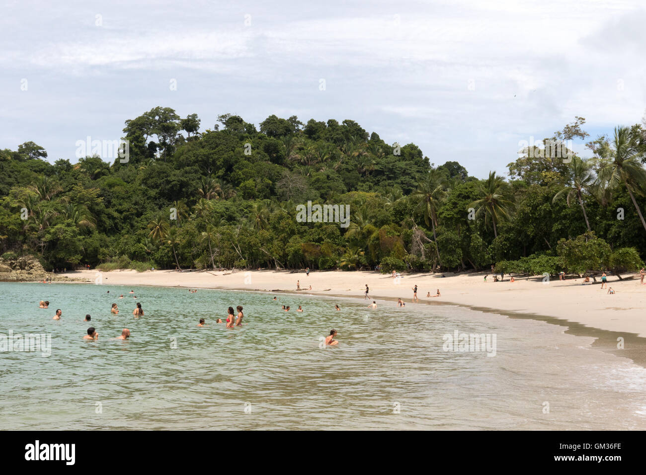 Tourists bathing in the Pacific Ocean, Manuel Antonio national park beach, pacific coast, Costa Rica, Central America Stock Photo
