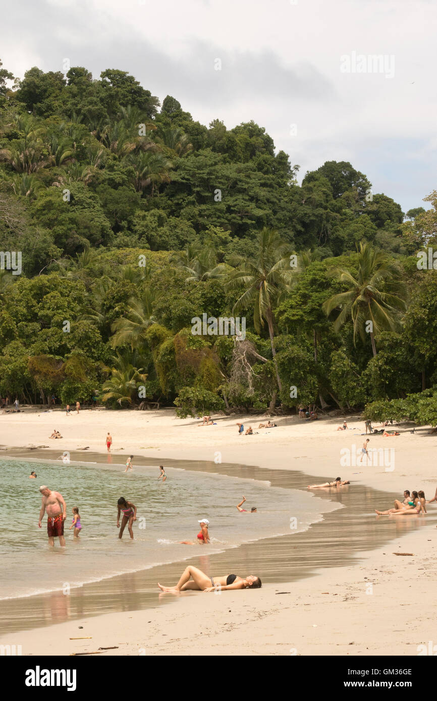 Sunbathers on the beach, Manuel Antonio National Park, Pacific coast, Costa Rica, Central America - Stock Image