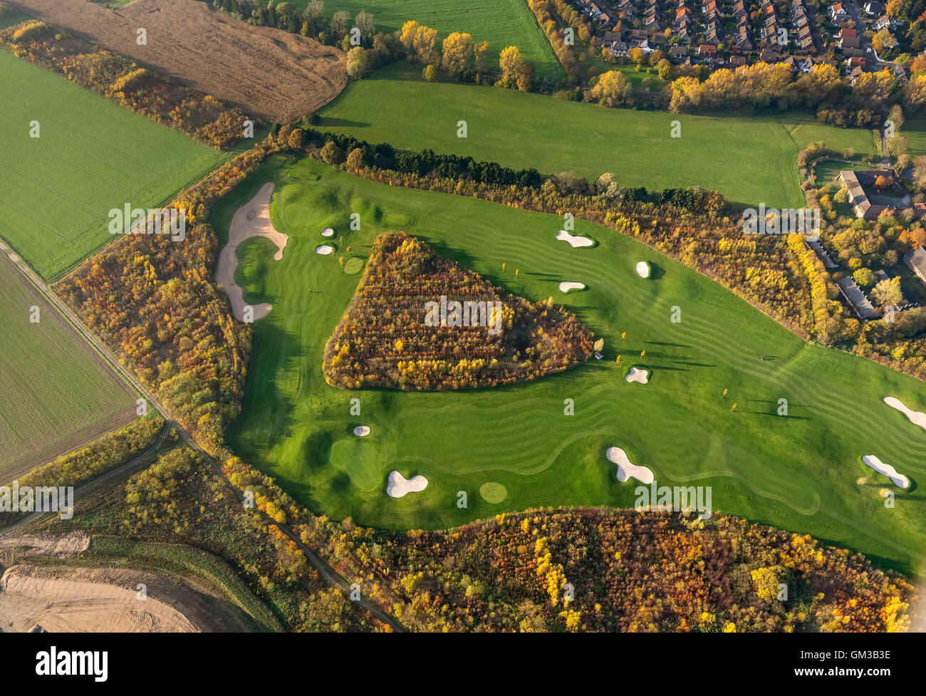 Aerial view, golf and more Duisburg Huckingen, Golf Course Duisburg, bunkers, sand pits, triangle Woods am Remberger - Stock Image