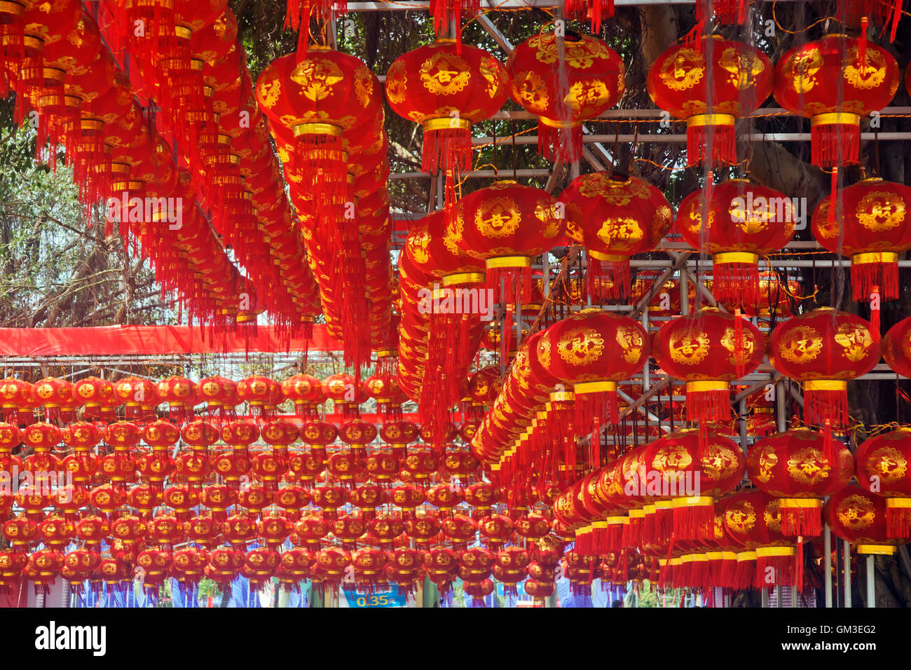 Chinese New Year red lanterns hanging high above Stock Photo