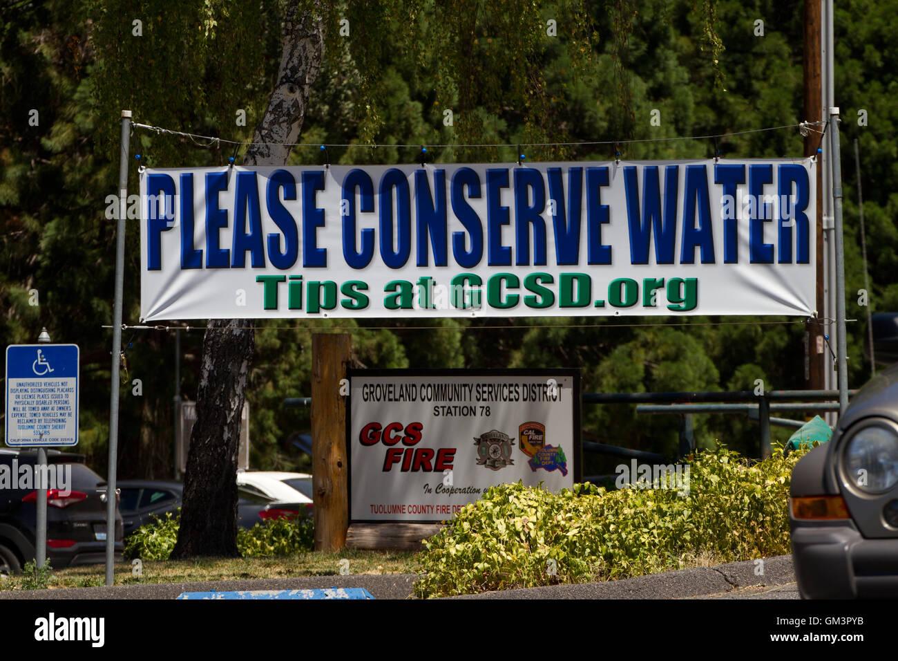 Please conserve water placard Groveland. California - Stock Image