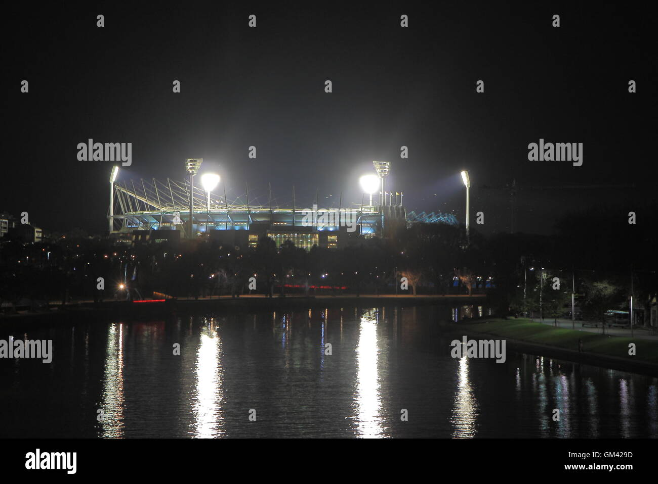MCG by night over Yarra river Melbourne Australia - Stock Image