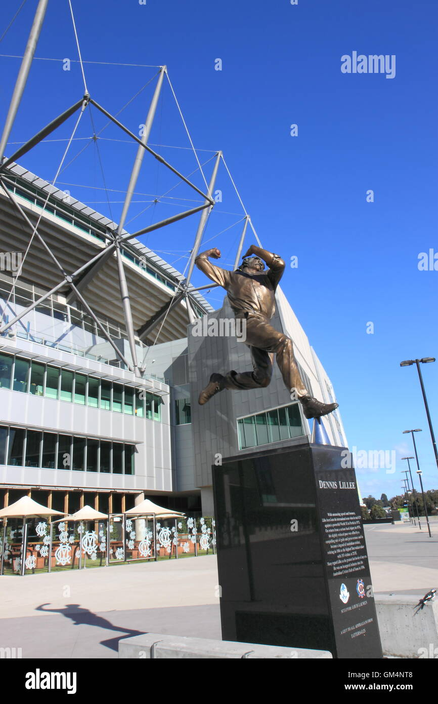 MCG and statue of Dennis LelleeAustralian cricket player in Melbourne Australia. - Stock Image