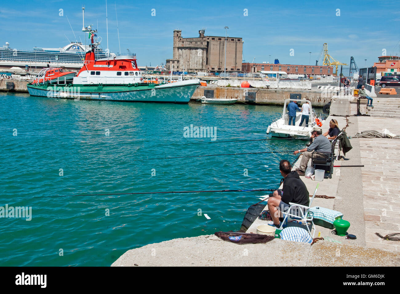 Fishing from the quayside at Livorno, Italy - Stock Image