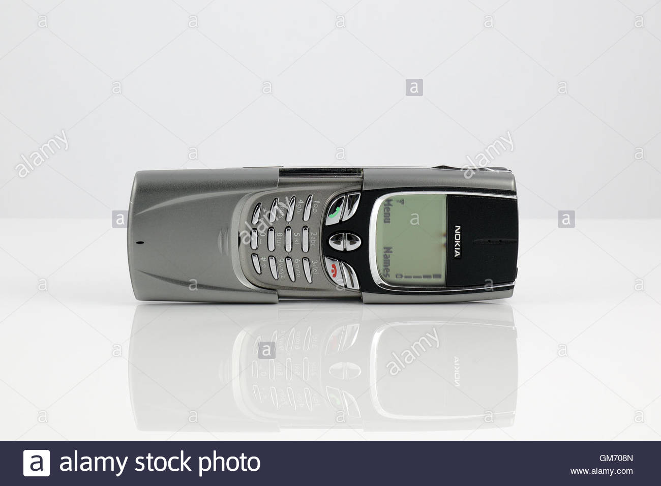 Nokia 8890 mobile phone reflecting off a white surface - Stock Image