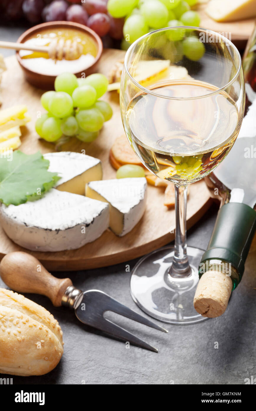 White wine grape bread cheese plate and honey on stone table & White wine grape bread cheese plate and honey on stone table ...