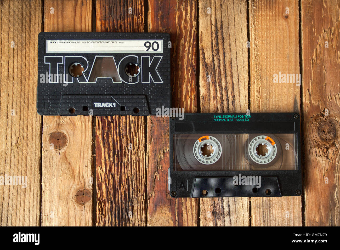 Audio cassette tape on old wooden background - Stock Image