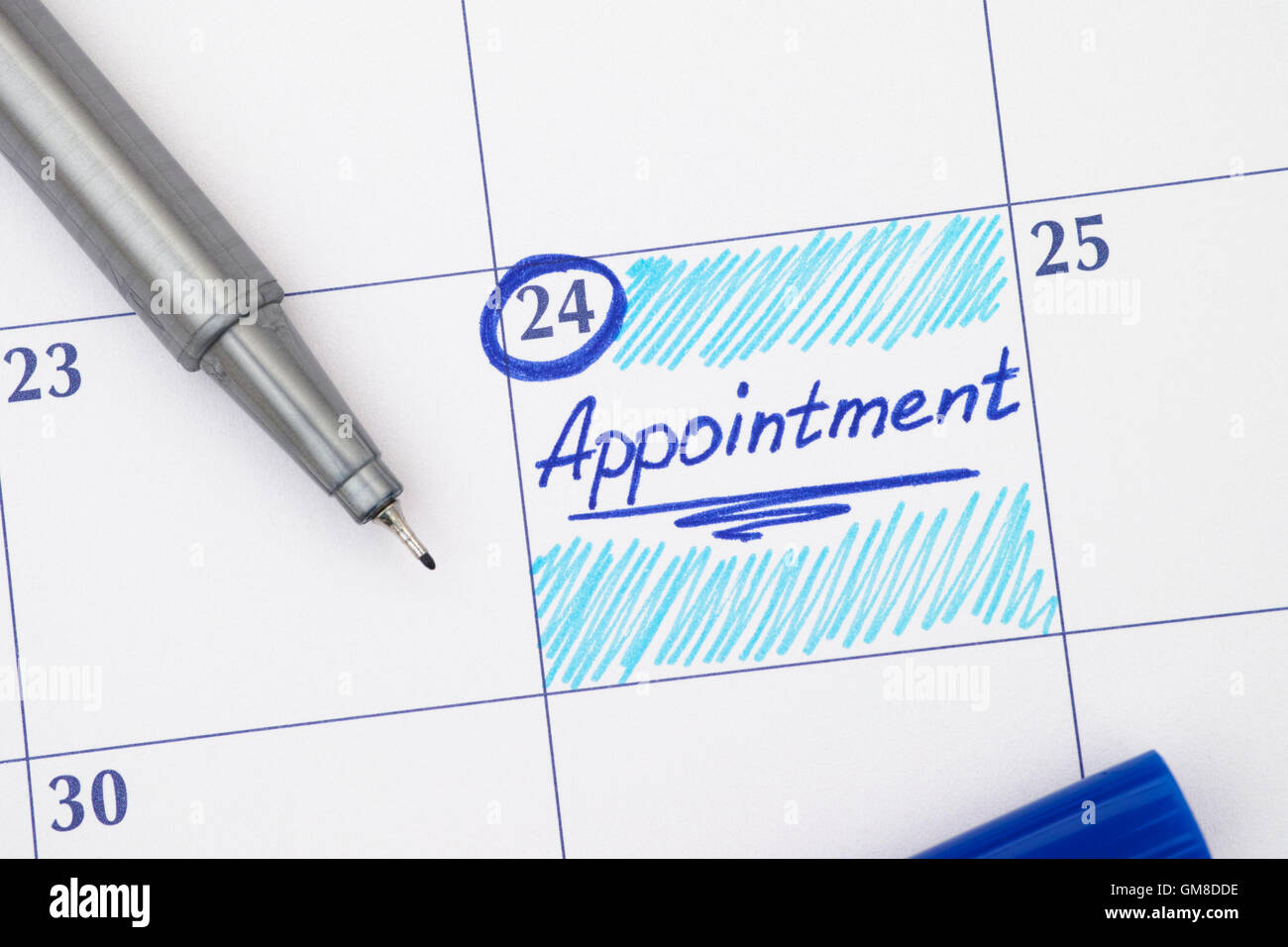 Reminder Appointment in calendar with blue pen - Stock Image