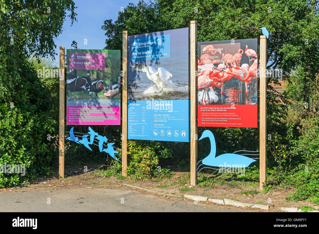 Signs at the entrance to the Wildfowl and Wetlands Trust's Slimbridge Nature Reserve, Slimbridge, Gloucestershire - Stock Image