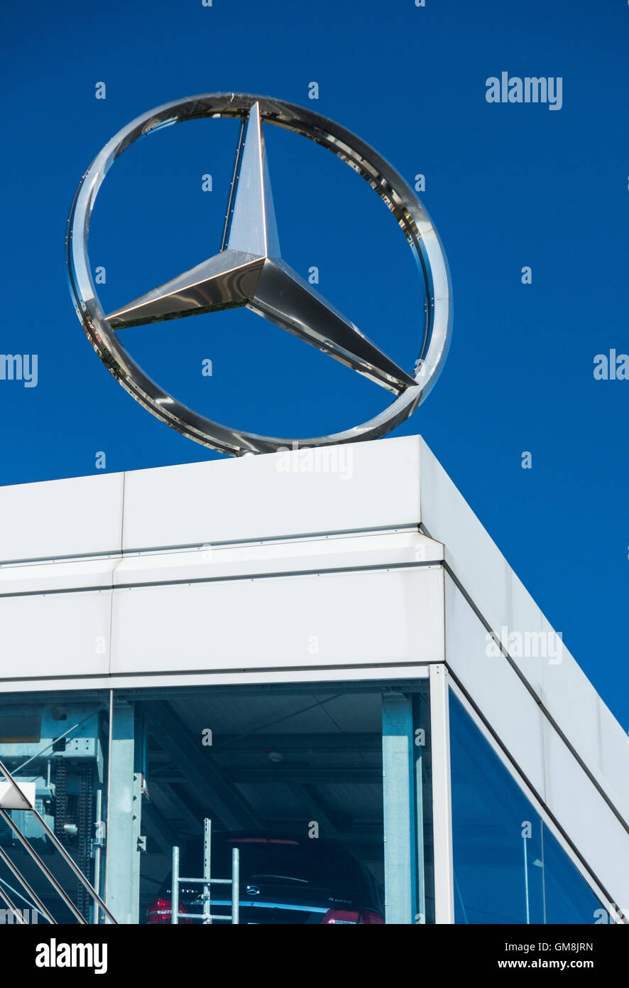 The Mercedes Benz logo on top of a showroom in Brentford, west London, UK Stock Photo
