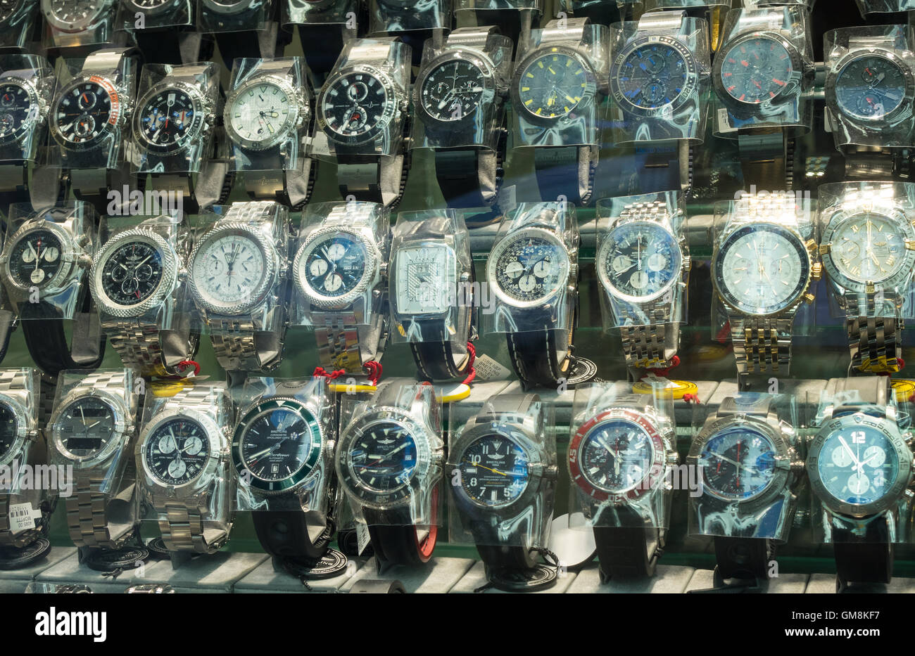 Men's wrist watches on display in the window of a shop on 47th Street in New York City - Stock Image