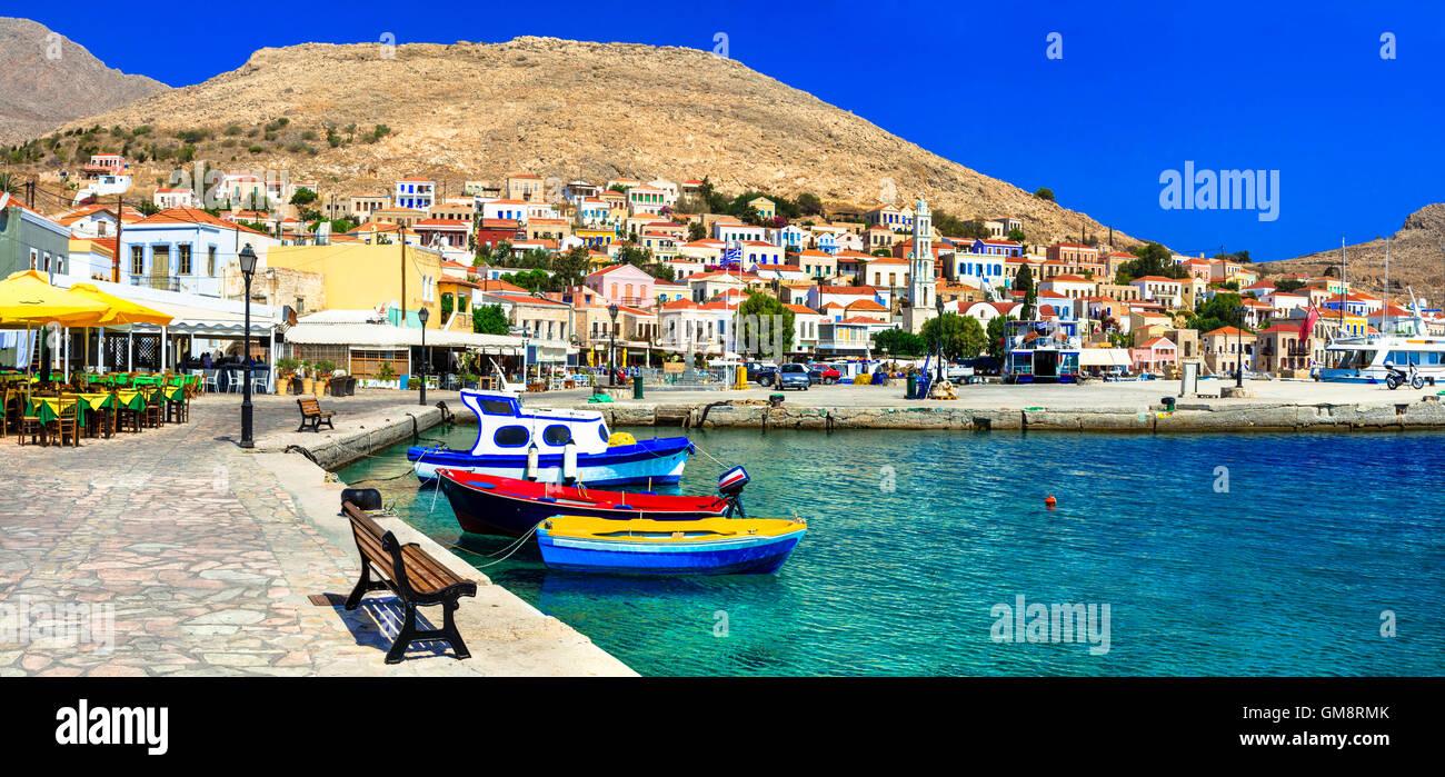 traditional Greece series - Chalki island with tavernas and fishing boats - Stock Image
