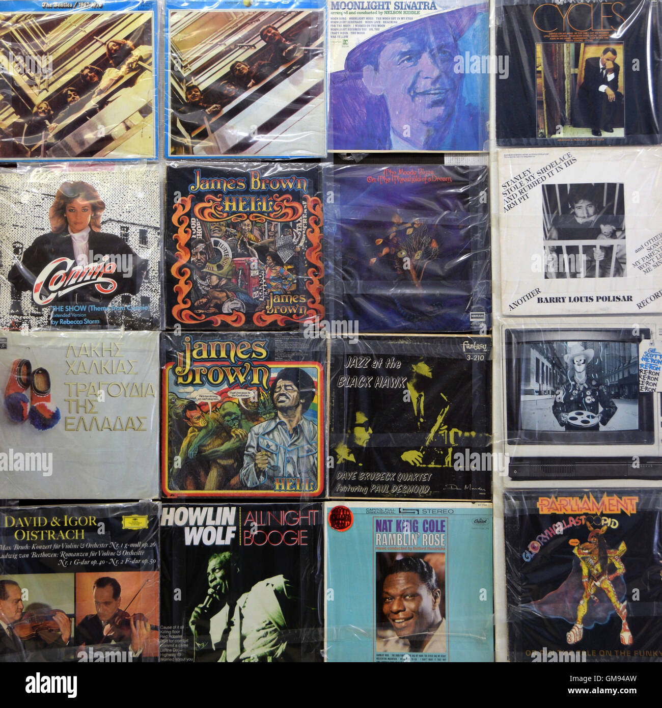 Wall With Vintage Vinyl Records Old Lp Album Covers In Plastic Stock